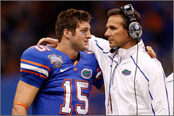 In their final game together, Florida quarterback Tim Tebow, left, and head coach Urban Meyer guided the Gators to a 51-24 Sugar Bowl win against Cincinnati.
