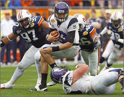 Auburn's Craig Stevens (46) and Derrick Lykes take down Northwestern quarterback Mike Kafka.