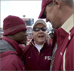 Warrick Dunn, left, and Chris Weinke were among the more than 300 former Florida State players who came to watch Bobby Bowden in his final game at the helm.