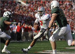 Ohio State quarterback Terrelle Pryor, center, amassed 338 total yards and threw two touchdown passes as the Buckeyes blitzed Oregon 26-17 in the Rose Bowl. Pryor was named the game's MVP.