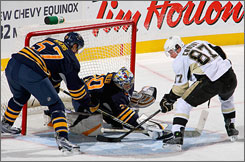 Buffalo's Ryan Miller, the likely No. 1 goaltender for the USA, stops a shot from Pittsburgh and Canada star Sidney Crosby.