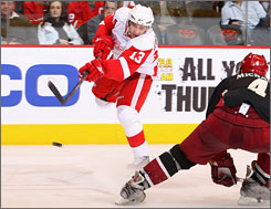 Detroit's Pavel Datsyuk shoots the puck past Phoenix's Zbynek Michalek during the third period. Datsyuk scored a power-play goal as the Red Wings won their second straight game.