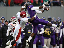 Arkansas safety Elton Ford, left, breaks up a pass to East Carolina wide receiver Dwayne Harris in a game decided by made and missed field goals.