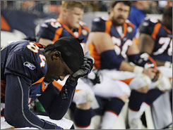 Brandon Lloyd, left, and the Broncos lost eight of their final 10 games.