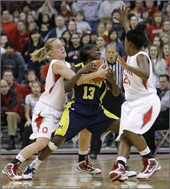 Ohio State's Maria Moeller, left, and Shavelle Little, right, trap Michigan's Dayeesha Hollins during the second half of the Buckeyes' 59-56 win.