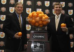 Iowa coach Kirk Ferentz, left, and Georgia Tech's Paul Johnson will be playing for an Orange Bowl win and conference bragging rights. The Big Ten and the ACC are each 3-3 this bowl season.