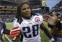 Titans RB Chris Johnson set the NFL record for yards from scrimmage and became just the sixth player in history to rush for 2,000 yards in one season on Sunday.