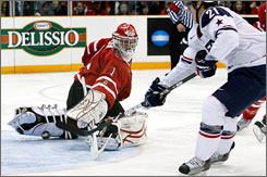 New York Rangers prospect Derek Stepan scores against Canada goalie Jake Allen in the third period. Allen was pulled after the goal.