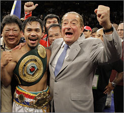"Promoter Bob Arum, right, says his boxer, Manny Pacquiao, was agreeable to a fight with Floyd Mayweather Jr., but ""Mayweather walked away."""