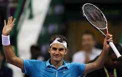 World No. 1 Roger Federer celebrates his victory Wednesday against Evgeny Korolev at the Qatar ATP Open Tennis tournament in Doha, Qatar.