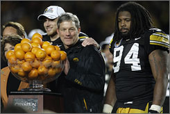 Iowa football coach Kirk Ferentz celebrates after his Hawkeyes defeated Georgia Tech 24-14 in the Orange Bowl. Iowa returns all but two starters on defense next season and could be in the running for next year's national title game.