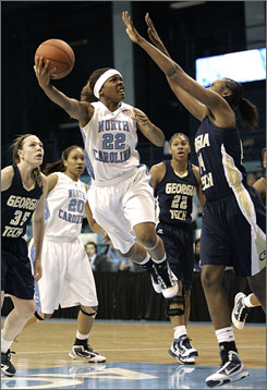 North Carolina's Cetera DeGraffenreid drives into the lane as Georgia Tech's LaQuananisha Adams, right, defends during the Tar Heels' 89-78 win.