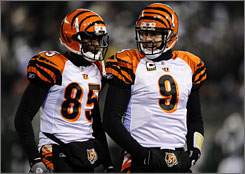 Bengals WR Chad Ochocinco, left, and QB Carson Palmer host the Jets on Saturday in a wild-card matchup.
