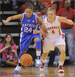 Ashley Houts (1) scored a career-high 27 points to help Georgia edge Amber Smith and Kentucky.