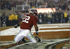 Alabama's Mark Ingram celebrates his touchdown in the fourth quarter during the Crimson Tide's 37-21 victory over Texas in the BCS title game.