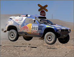 Carlos Sainz launches his Volkswagen during a sandy portion of Friday's seventh stage at the Dakar Rally.