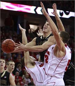 Purdue's Chris Kramer, center, drives and shoots beween Wisconsin's Jason Bohannon, left, and Keaton Nankivil.