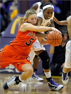 Auburn's Alli Smalley (5), fighting LSU's Allison Hightower for a loose ball, forced overtime with her three-pointer with 3.1 seconds left in regulation.