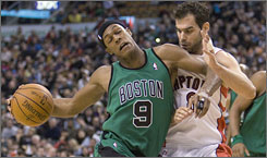 Celtics guard Rajon Rondo collides with Raptors defender Jose Calderon during the first half.