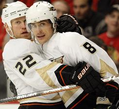 The Anaheim Ducks' Teemu Selanne, right, celebrates with teammate Todd Marchant after Selanne scored during the third period against the Chicago Blackhawks. The Ducks won 3-1 Sunday night in Chicago.