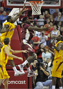 Landon Milbourne, trying to block Florida State's Chris Singleton during the first half, and Maryland nearly blew a 16-point lead to the Seminoles.