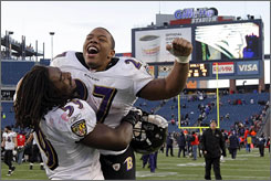 The Ravens' Dannell Ellerbe, left, and Ray Rice helped the team to a win in Foxborough that sent them to the divisional playoffs.