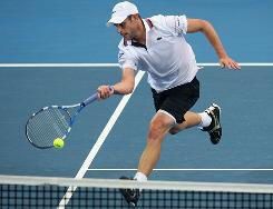 Andy Roddick of the USA rushes in to play a forehand during his victory Sunday against Radek Stepanek in the final of the Brisbane Intternational.