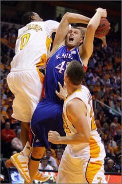 Renaldo Woolridge (No. 0), battles Kansas' Cole Aldrich for a rebound, Bruce Pearl and No. 15 Tennessee overcame the dismissal of Tyler Smith and the suspension of three players to upset the top-ranked Jayhawks.