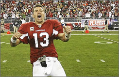 Kurt Warner and the Cardinals moved on to the divisional playoffs with an overtime defeat of the Packers on Sunday.
