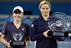 Belgian stars Kim Clijsters, right, and Justine Henin, played a thrilling final Saturday in Brisbane, won by Clijsters. Henin was in her first tournament after an 18-month retirement, and Clijsters was in her fifth tournament after returning from retirement.