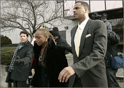 Jayson Williams leaves Somerset County (N.J.) Courthouse with his wife, Tanya, after entering a guilty plea Monday.