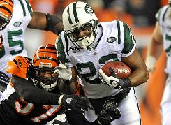 Jets running back Shonn Greene breaks a tackle attempt by Bengals linebacker Dhani Jones during the second half of the AFC Wild Card playoff game last Saturday.