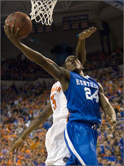 Kentucky's Eric Bledsoe, shooting around Florida's Vernon Macklin, scored a career-high 25 points to help the second-ranked Wildcats remain undefeated. 