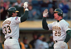 Jose Canseco, left, and Mark McGwire were teammates with the Oakland Athletics from 1986-92.