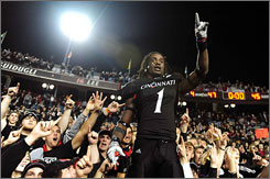 Wide receiver Mardy Gilyard and the winning Cincinnati football team have brought a new mood to the school, but some on campus question the finances involved in the Bearcats' success.