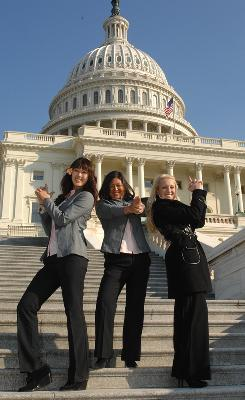 Michelle Wie, Christina Kim and Natalie Gulbis of the 2009 U.S. Solheim team poses for photo in front the Capital during visit to celebrate the victory with a visit to the White House.