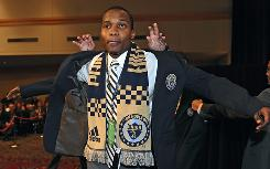 Top pick Danny Mwanga puts on a Philadelphia Union blazer at the 2010 MLS SuperDraft at the Pennsylvania Convention Center in Philadelphia.
