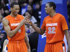 Wes Johnson, left, and Kris Joseph of No. 5 Syracuse face No. 9 West Virginia on Saturday, the Orange's first road game against a ranked opponent.