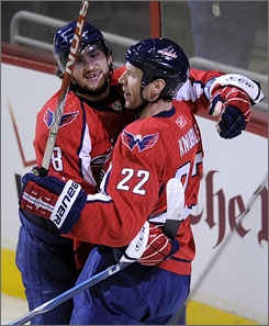 Alex Ovechkin, left, scored a goal and notched four assists while teammate Mike Knuble scored twice to propel the Capitals to victory.