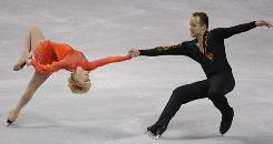 Pairs skaters Caydee Denney and Jeremy Barrett moved into first place while other competitors stumbled Friday.