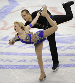 Caydee Denney and Jeremy Barrett perform their free program at nationals on Saturday.