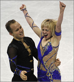 Jeremy Barrett and Caydee Denney celebrate at the end of their free program Saturday. The pair won the national title by almost 17 points over second-place finishers Amanda Evora and Mark Ladwig.