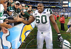 D'Brickashaw Ferguson and the Jets defeated the Chargers to clinch a berth in the AFC title game.