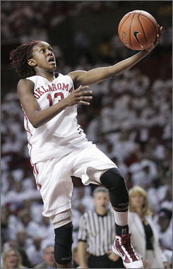 Oklahoma guard Danielle Robinson, going up for a layup against Texas A&M, scored 24 points to lift the Sooners to a 74-65 win.