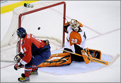 Capitals' Alex Ovechkin, left, scores a goal on a penalty shot against Flyers goalie Ray Emery during the third period.
