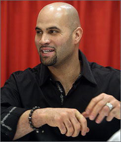 St. Louis first baseman Albert Pujols engages fans as he signs autographs at the Cardinals' annual Winter Warm-up event.