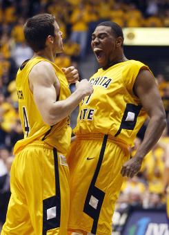 Wichita State's JT Durley and Graham Hatch celebrate after a basket during the Shockers' 60-51 upset win over Northern Iowa.