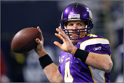Brett Favre and the Vikings moved on to the NFC title game with a win against the Cowboys.
