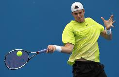 John Isner of the USA lines up a forehand in his first-round victory Tuesday against Andreas Seppi of Italy at the Australian Open in Melbourne.