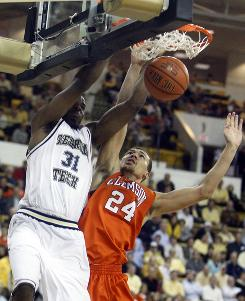 Georgia Tech's Gani Lawal scores as Clemson's Milton Jennings defends in the first half of the Yellow Jackets' 66-64 victory.